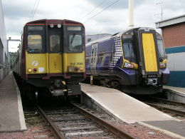 Image of Class 314 and Class 380 units at Corkerhill depot