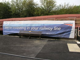 Network Rail banner 'we're investing in your railway line' at Charlbury